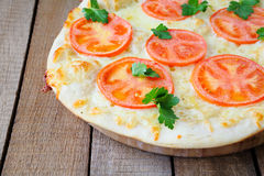 Round pizza with tomatoes Royalty Free Stock Images
