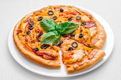 Round pizza on a white plate stock images