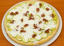 Round pizza with zucchini and sausa Stock Photo