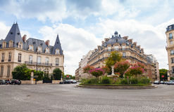 Round Place Francois 1er with old fountain, Paris Royalty Free Stock Photography