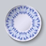 Round plate with flower painting. Stylized Gzhel. Stock Photography