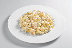 Round plate with pop corn Stock Images