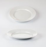 Round plates or dishes on white background Stock Photo