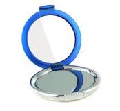 Round pocket makeup mirror. On white Royalty Free Stock Image