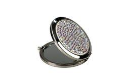 Round pocket makeup mirror with stones on white Stock Image