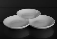 Round porcelain bowl with three compartments. front view. Round porcelain bowl with three compartments Royalty Free Stock Photo
