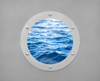 Round porthole and sea wave Royalty Free Stock Photo