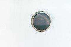Round porthole on the ship white wall Stock Images
