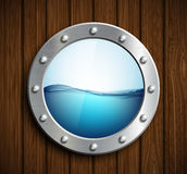 Round porthole on a wooden surface. Stock Photos