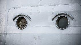 Round portholes warship Stock Image