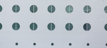 Round Portholes on White Hull Stock Image