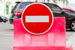 Round prohibitory traffic sign on a black car. Round prohibitory sign traffic plastic barrier in front of a black car Royalty Free Stock Photos