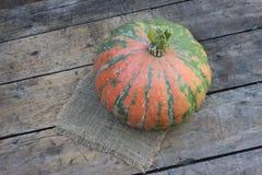 Round pumpkin on board Stock Image