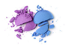 Round purple and blue crashed eyeshadows for makeup as sample of cosmetics product Royalty Free Stock Photo
