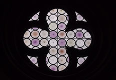 Round purple stained glass window with cross. Or flower design Stock Image