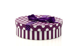 Round purple and white gift box Stock Images