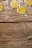 Round ravioli pasta dusted with floor on wooden background Royalty Free Stock Image