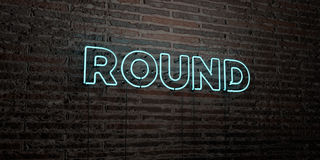 ROUND -Realistic Neon Sign on Brick Wall background - 3D rendered royalty free stock image. Can be used for online banner ads and direct mailers Royalty Free Stock Photo