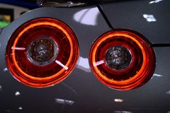 Round rear light of japanese sport car, silver chassis. Round red rear light with LED on japanese sport car. Car was displayed on Car Expo, propably Nissan Royalty Free Stock Photography