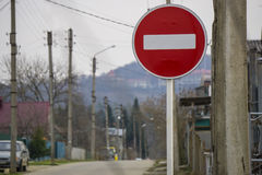 Round red road sign on metal pole. No Entry road-sign mounted on urban roadside.  royalty free stock photo