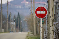 Round red road sign on metal pole. No Entry road-sign mounted on urban roadside.  royalty free stock photography