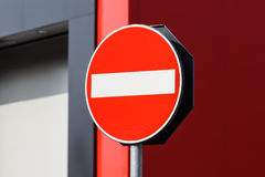 Round red road sign on metal pole. No Entry road-sign mounted on urban roadside.  royalty free stock images
