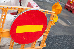 Round red sign No Entry mounted on road barrier Stock Photos