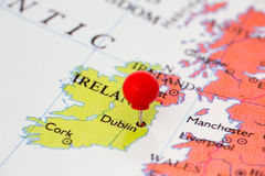 Red Pushpin on Map of Ireland. Round red thumb tack pinched through city of Dublin on Ireland map. Part of collection covering all major capitals of Europe Royalty Free Stock Photography