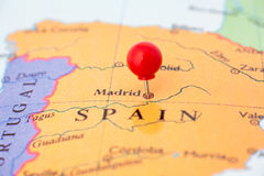 Red Pushpin on Map of Spain. Round red thumb tack pinched through city of Madrid on Spain map. Part of collection covering all major capitals of Europe Royalty Free Stock Image