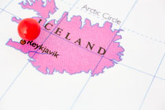 Red Pushpin on Map of Iceland. Round red thumb tack pinched through city of Reykjavik on Iceland map. Part of collection covering all major capitals of Europe Stock Photo
