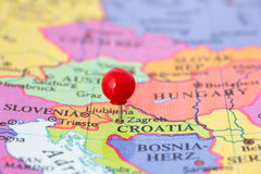Red Pushpin on Map of Croatia. Round red thumb tack pinched through city of Zagreb on Croatia map. Part of collection covering all major capitals of Europe Royalty Free Stock Photos
