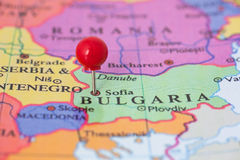 Red Pushpin on Map of Bulgaria. Round red thumb tack pinched through Sofia on Bulgaria map. Part of collection covering all major capitals of Europe Royalty Free Stock Photos