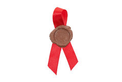 Round red wax seal on a red ribbon Royalty Free Stock Photos
