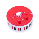Round red and white gift box. On white Stock Photos