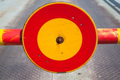 Round red and yellow stop sign on turnpike Royalty Free Stock Image
