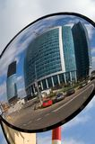 Round reflection. Reflection of an office center in Moscow, Russia in a round road mirror. At the background is construction dite of a new office Stock Photography