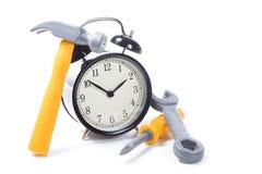 Round retro alarm clock with tools stock photos