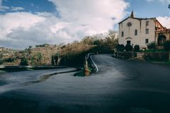 Round Road with Church Italy. Round Road with Church near Tuscany, Italy, on an approach to a major city royalty free stock photography