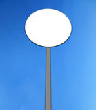 Round road sign. Isolated in sky background Royalty Free Stock Images