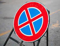 Round road sign stands on urban roadside. Standing is prohibited royalty free stock photos