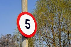 Round road speed limit sign on the pole Stock Images