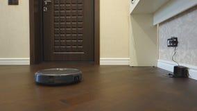 Round robotic vacuum cleaner stock video footage