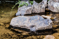 Round rock in watershed Royalty Free Stock Photos