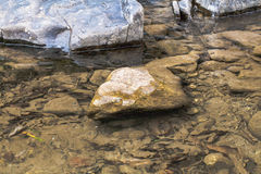 Round rock in watershed Stock Photo