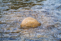 Round rock in watershed Royalty Free Stock Photography