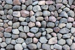 Round rocks stacked outside stock image