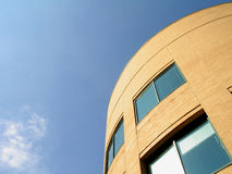 Round Roofline. Curved roofline against blue sky stock photo