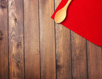 Round rope napkin or stand, red place mat  and spoon on a wooden Royalty Free Stock Photos