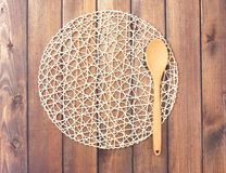 Round rope napkin or stand and spoon on a wooden rustic table Stock Images