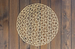 Round rope napkin or stand on a wooden rustic table Royalty Free Stock Image